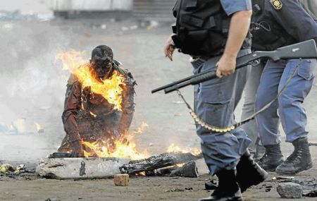 South Africa Is Breaking My Heart, I Cry For My Beloved Country - White Privilidge Racism Rhodes Must Fall Xenophobia SA's xenophobia shame: 'burning man' case shut BEAUREGARD TROMP | 19 February, 2015 15:30 Mozambican Ernesto Nhamuave was set alight by a mob in Ramaphosa informal settlement on the East Rand in May 2008.