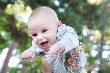 Caffeine and Fairydust - Our Family Photoshoot With Lauren Pretorius Photography Hand Tattoo Holding Baby Up In The Air Mom With Tattoos
