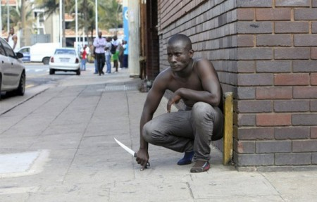 South Africa Is Breaking My Heart, I Cry For My Beloved Country - White Privilidge Racism Rhodes Must Fall Xenophobia A foreign national holds a knife following clashes between a group of locals and police in Durban on April 14 ,2015 amidst ongoing violence against foreign nationals living in Durban. Photo: STRINGER / AFP